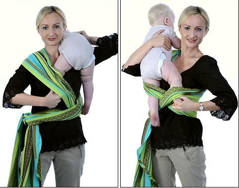 Возьмите ребенка на руки, положите его на плечо, заправьте одну ножку под противоположное полотнище креста, как на фотографии. Затем переложите ребенка на другое плечо и заправьте другую ножку под внешнее полотнище креста и над внутренним полотнищем креста